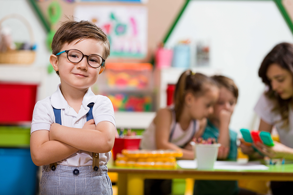 little boy in childcare playroom image