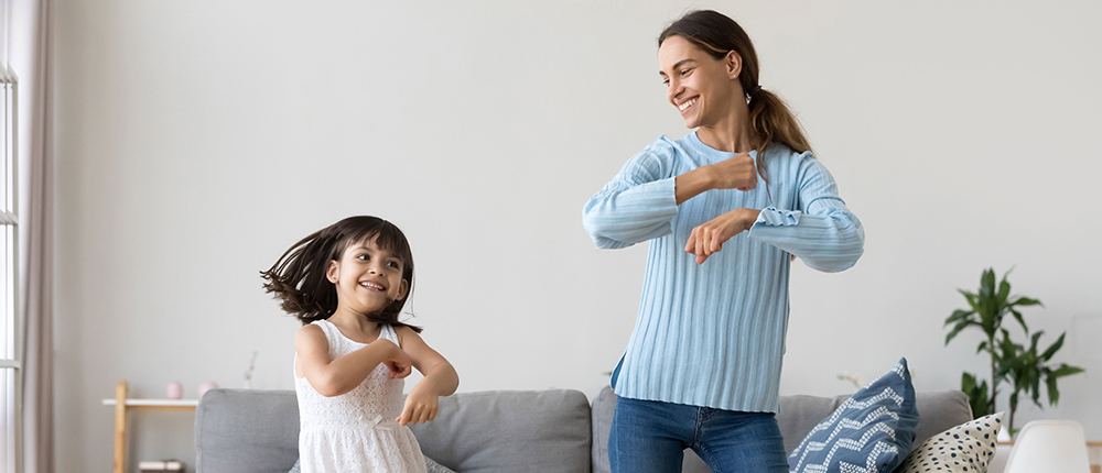 woman dancing with little girl smiling image